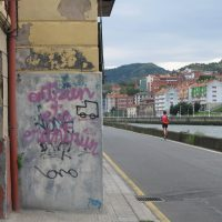 scribbled wall and jogger