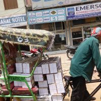 cycle rickshaw delivering boxes
