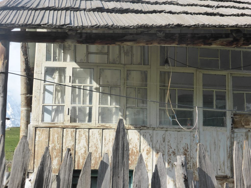 bleached white wooden house frontage