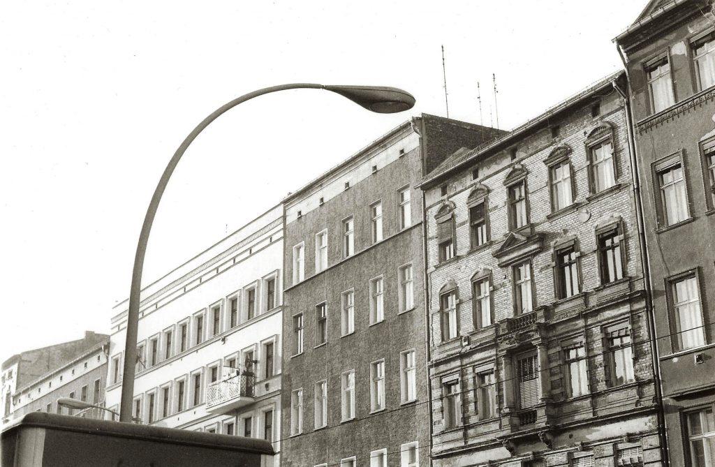 building facades meet curvy streetlamp