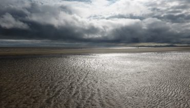silvery sand under big sky